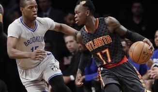 Brooklyn Nets' Isaiah Whitehead (15) defends Atlanta Hawks' Dennis Schroder (17), of Germany, during the first half of an NBA basketball game Tuesday, Jan. 10, 2017, in New York. (AP Photo/Frank Franklin II)