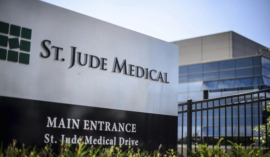 This Wednesday, July 22, 2015, file photo shows St. Jude Medical corporate headquarters, in Little Canada, Minn., just north of St. Paul. (Glen Stubbe/Star Tribune via AP, File)