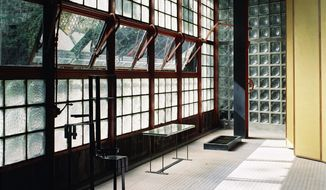 """This undated photo provided by the Jewish Museum shows Pierre Chareau's (French, 1883-1950) and Bernard Bijvoet's (Dutch, 1889-1979), glass house Maison de Verre. The photo is part of the exhibition """"Pierre Chareau: Modern Architecture and Design,"""" at The Jewish Museum in New York. (Mark Lyon/The Jewish Museum via AP)"""
