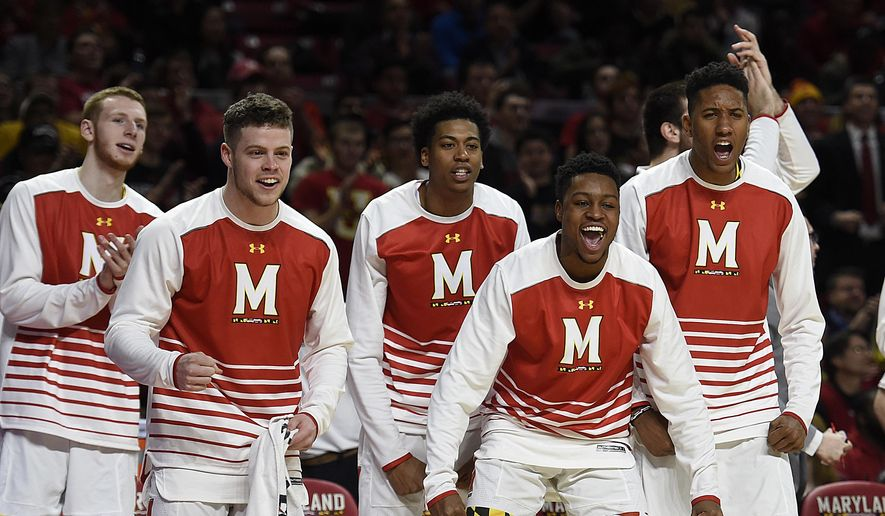 Maryland players on the bench celebrate during the first half of the team's game against Indiana on Tuesday in College Park, Md. (Associated Press)