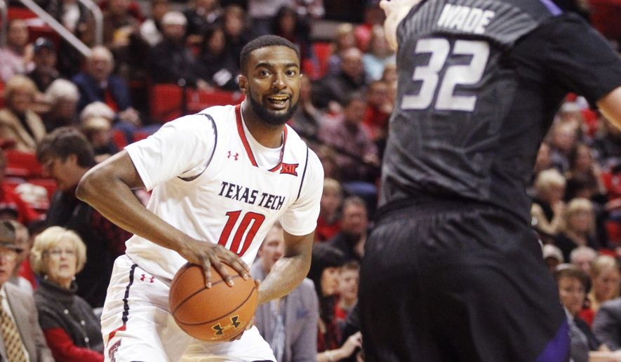 Texas Tech guard Niem Stevenson (10) looks for an open teammate defended by Kansas State forward Dean Wade (32) during the first half of an NCAA college basketball game, Tuesday, Jan. 10, 2017, in Lubbock, Texas. (AP Photo/Mark Rogers)