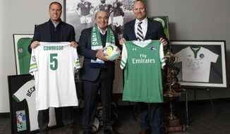 In this image provided by the New York Cosmos, Rocco B. Commisso, center, the New York Cosmos' new owner, poses with coach Giovanne Savarese, left, and chief operating office Erik Stover, Tuesday, Jan. 10, 2017, in New York. Commisso, chief executive of Mediacom Communications Corp. and a former soccer player at Columbia, said Tuesday he purchased majority ownership of the team in the second-tier North American Soccer League and will become the club's chairman. (New York Cosmos via AP)