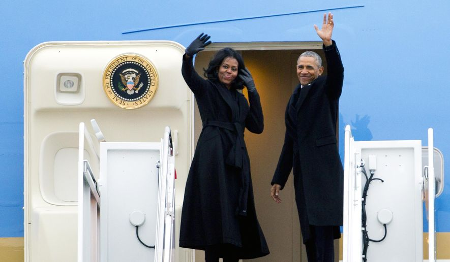 President Barack Obama and first lady Michelle Obama wave from Air Force One at Andrews Air Force Base, Md., Tuesday, Jan. 10, 2017. Obama is traveling to Chicago to give his presidential farewell address, continuing a tradition established by the nation's first president more than two centuries ago. ( AP Photo/Jose Luis Magana)