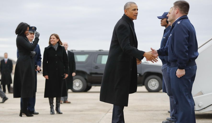 President Barack Obama greets members of Air Force One crew before boarding the plane with first lady Michelle Obama, left, at Andrews Air Force Base, Md., Tuesday, Jan. 10, 2017. Obama is traveling to Chicago to give his presidential farewell address, continuing a tradition established by the nation's first president more than two centuries ago. (AP Photo/Pablo Martinez Monsivais)