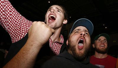 Alabama fans Bradley Williams, left, of Prattville, Ala., and Michael Mumpower, of Montgomery, Ala., cheer after an Alabama touchdown during the NCAA college playoff championship football game between Alabama and Clemson, as fans watched television coverage Monday, Jan. 9, 2017, in Tuscaloosa, Ala. (AP Photo/Brynn Anderson)