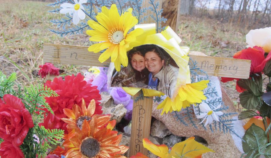 FILE - In this Nov. 26, 2013, file photo, a memorial is left at the scene of an unsolved shooting that killed Brittany Stykes, left in the photo, and her unborn child, in Ripley, about 45 miles southeast of Cincinnati, Ohio. Authorities in southern Ohio plan to discuss renewed efforts Tuesday, Jan. 10, 2017, to solve the August 2013 slaying of Stykes and her unborn child. Her then-14-month-old daughter survived a gunshot wound to the head. (AP Photo/Amanda Lee Myers, File)