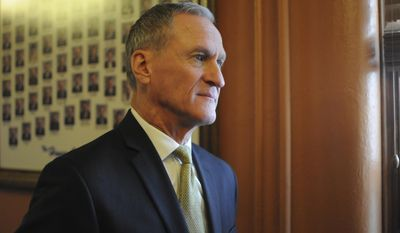 In this Tuesday, Jan. 10, 2017 photo, South Dakota Gov. Dennis Daugaard waits to give his State of the State address at the state Capitol in Pierre, S.D. (AP Photo/James Nord)