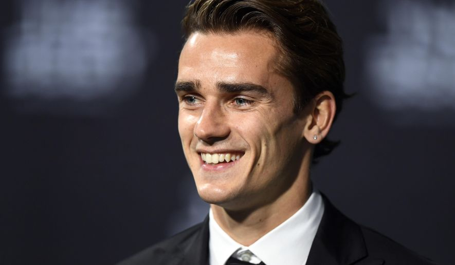 France's Antoine Griezmann arrives on the green carpet prior during the The Best FIFA Football Awards 2016 ceremony held at the Swiss TV studio in Zurich, Switzerland, Monday, Jan. 9, 2017. (Walter Bieri/Keystone via AP)