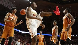 Iowa State guard Deonte Burton, center, reacts after dunking the ball during the second half of an NCAA college basketball game against Texas, Saturday, Jan. 7, 2017, in Ames, Iowa. (AP Photo/Charlie Neibergall)