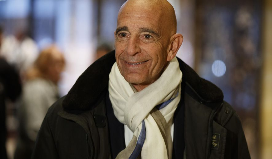 Tom Barrack, chairman of the inaugural committee, speaks with reporters in the lobby of Trump Tower in New York, Tuesday, Jan. 10, 2017, before meeting with President-elect Donald Trump. (AP Photo/Evan Vucci)