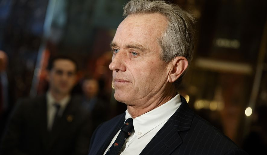 Robert F. Kennedy Jr. talks with reporters in the lobby of Trump Tower in New York, Tuesday, Jan. 10, 2017, after meeting with President-elect Donald Trump. (AP Photo/Evan Vucci)
