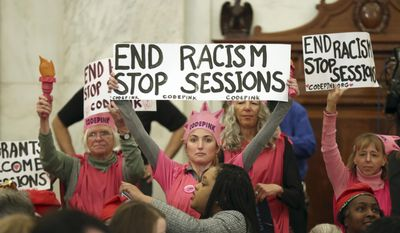 Protestors from CodePink, including co-founder Medea Benjamin take part in a demonstration on Capitol Hill in Washington, Tuesday, Jan. 10, 2017, during Senate Judiciary Committee's confirmation hearing for Attorney General-designate, Sen. Jeff Sessions, R-Ala. (AP Photo/Andrew Harnik)