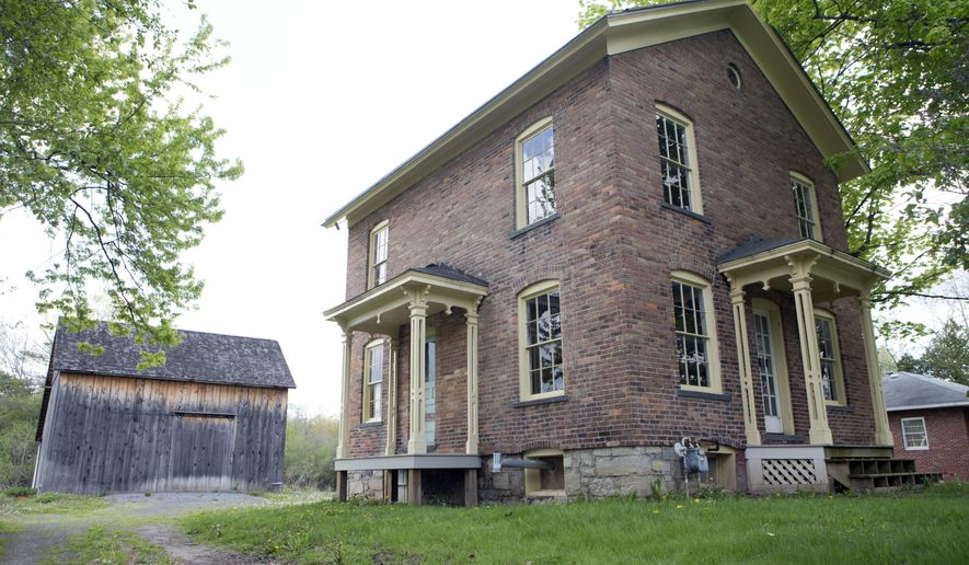 FILE- In this May 19, 2016, file photo, the Harriet Tubman Residence is seen at the Harriet Tubman Home in Auburn, N.Y. New York lawmakers and federal parks officials are gathering in Washington, to formally establish the Harriet Tubman National Historical Park in New York. U.S. Interior Secretary Sally Jewell will preside over an official signing ceremony Tuesday, Jan. 10, 2017, that will make the park part of the National Park System. (AP Photo/Mike Groll, File)