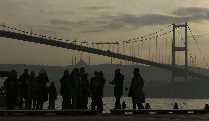 In this photo taken on Wednesday, Jan. 4, 2017, people stand by the Bosporus Strait in Istanbul. These days, with a string of terror attacks targeting Istanbul still fresh in his memory, some residents say they are adapting their daily routines because of fears they could become the latest victims of violent extremism. (AP Photo/Emrah Gurel)