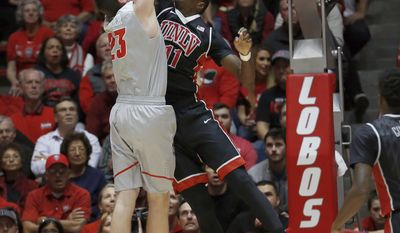 UNLV's Cheickna Dembelel blocks the shot attempt of New Mexico's Joe Furstinger during the first half of an NCAA college basketball game, Tuesday, Jan. 10, 2017, in Albuquerque, N.M. (AP Photo/Eric Draper)
