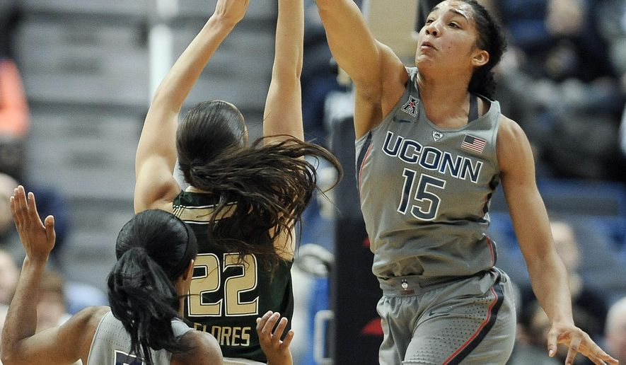 Connecticut's Gabby Williams blocks a shot attempt by South Florida's Laia Flores, center, as Connecticut's Crystal Dangerfield left, defends, in the first half of an NCAA college basketball game, Tuesday, Jan. 10, 2017, in Hartford, Conn. (AP Photo/Jessica Hill)