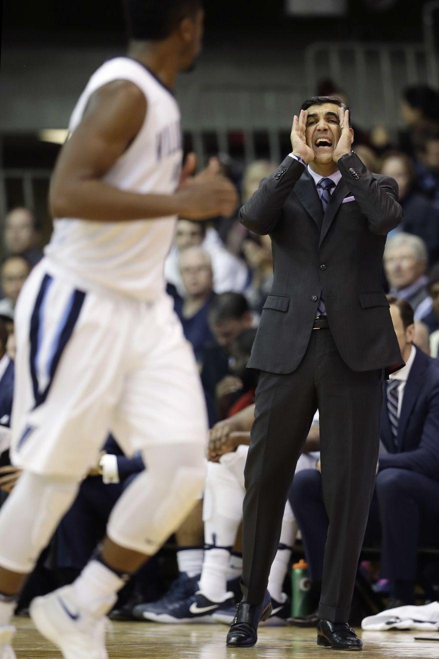 Villanova coach Jay Wright, right, yells to his team during the first half of an NCAA college basketball game against Xavier, Tuesday, Jan. 10, 2017, in Villanova, Pa. (AP Photo/Matt Slocum)