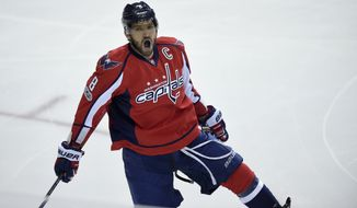 Washington Capitals left wing Alex Ovechkin (8), of Russia, celebrates his goal during the first period of an NHL hockey game against the Pittsburgh Penguins, Wednesday, Jan. 11, 2017, in Washington. Ovechkin didn't wait long to hit another milestone in his illustrious career, becoming the 84th player in NHL history to record 1,000 points.  (AP Photo/Nick Wass)