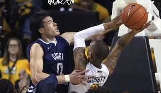 (file) Virginia Commonwealth's Samir Doughty , right, is fouled by George Washington's Yuta Watanabe during an NCAA college basketball game in Richmond, Va., Wednesday, Jan. 11, 2017. ( Joe Mahoney/Richmond Times-Dispatch via AP)