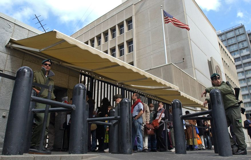 An Israeli border policemen guards the U.S. Embassy in Tel Aviv as Israelis line up for U.S. visas in this March 17, 2003, file photo. (AP Photo/Eitan Hess-Ashkenazi, File)