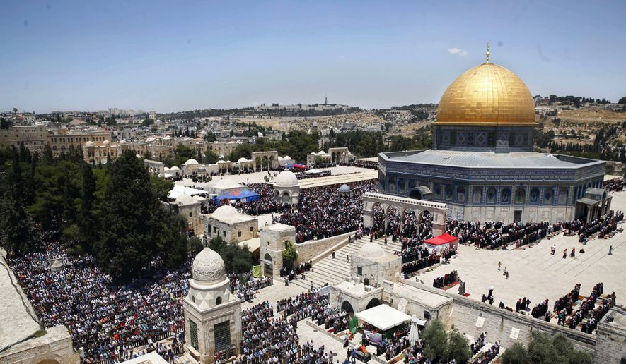 In this June 17, 2016, photo, Palestinians pray in the Al Aqsa Mosque compound during the Muslim holy month of Ramadan, in Jerusalem's Old City. (AP Photo/Mahmoud Illean, File)