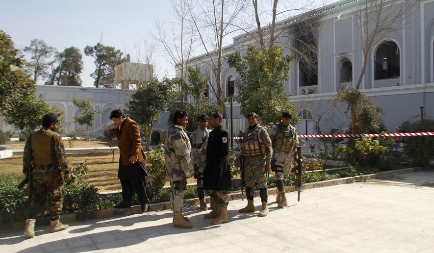 Afghan security forces are seen in front of Kandahar guesthouse after a bomb blast in Kandahar, Afghanistan, Wednesday, Jan. 11, 2017. The United Arab Emirates said on Wednesday that five of its diplomats were killed in a bombing in southern Afghanistan the day before, the deadliest attack to ever target the young nation's diplomatic corps. (AP Photos/Allauddin Khan)