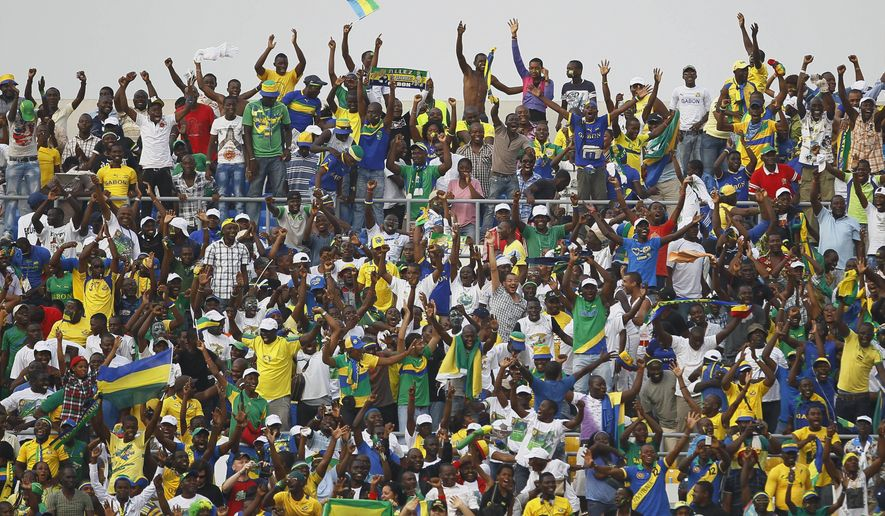 FILE - In this Monday, Jan. 23, 2012 file photo, Gabon fans celebrate after their national team scored against Niger in their African Cup of Nations Group C soccer match at Stade De L'Amitie in Libreville, Gabon. The African Cup of Nations returns to Gabon for the second time in five years with the kickoff on Saturday Jan. 14, 2017 and the final on Feb. 5. (AP Photo/Francois Mori, file)