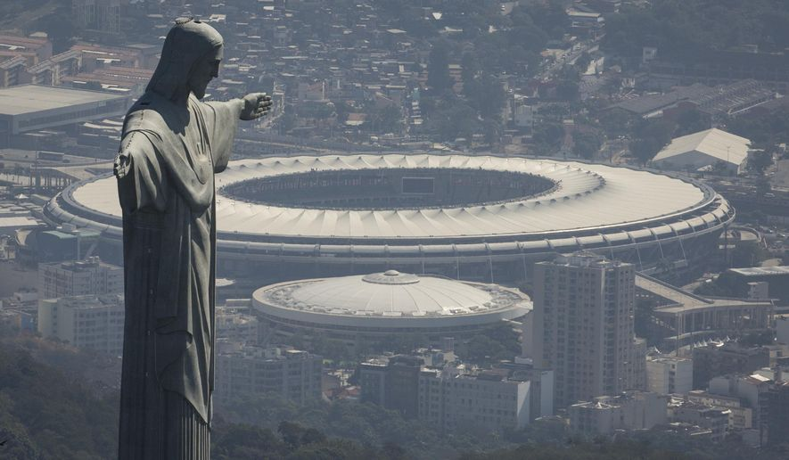 FILE - In this Aug. 1, 2016, file photo, the Christ the Redeemer statue stands above Maracana stadium in Rio de Janeiro, Brazil. Rio police said Wednesday, Jan. 11, 2017, that two bronze busts, two television sets and a piece of copper hose were stolen from iconic Stadium. (AP Photo/Felipe Dana, File)