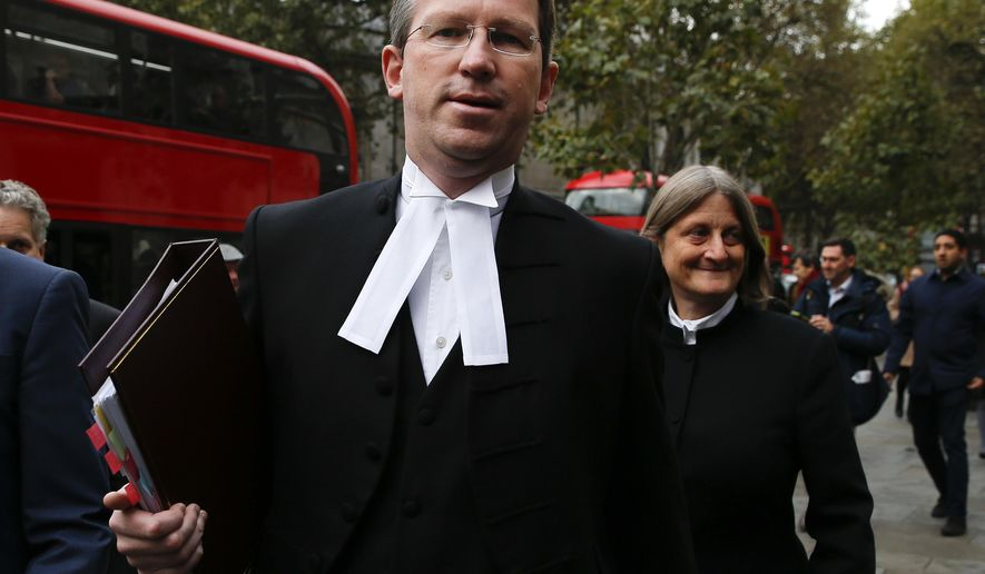 This is a Thursday, Oct. 13, 2016, file photo of Attorney General of England and Wales Jeremy Wright arrives at the High Court in London. Britain's top law officer  Jeremy Wright said Wednesday Jan. 11, 2017  it is legal to kill militants overseas if they pose an immediate and otherwise unstoppable threat. (AP Photo/Alastair Grant, File)