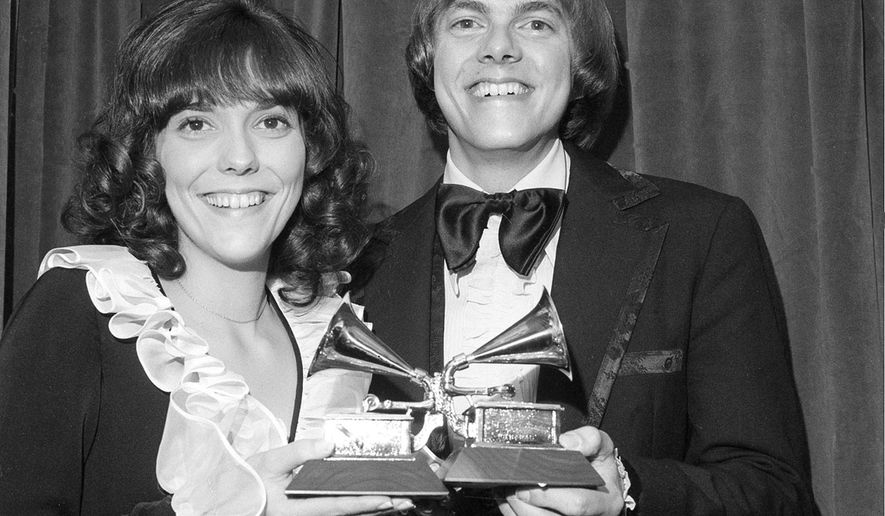 "FILE - This March 14, 1972 file photo shows Karen Carpenter, left, and Richard Carpenter, of The Carpenters, posing with their award for best pop vocal per during the 14th annual 1971 Grammy Awards in New York. Richard Carpenter sued Universal Music Group on Wednesday, Jan. 11, 2017, seeking more than $2 million in royalties he says are owed to him and the estate of his late sister for sales of digital music on services such as Apple's iTunes. The Carpenters won three Grammy Awards, including for their song ""Close to You."" (AP Photo/File)"