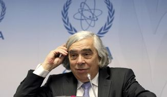 FILE - In this Sept. 26, 2016 file photo, Energy Ernest Moniz speaks in Vienna, Austria. Moniz says any effort to revive the long-dormant nuclear waste dump at Nevada's Yucca Mountain is doomed to fail because the project lacks support from elected officials in the state.  (AP Photo/Ronald Zak, File)