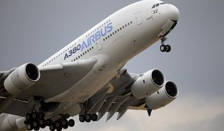 FILE - In this June 18, 2015 file photo, an Airbus A380 takes off for its demonstration flight at the Paris Air Show, in Le Bourget airport, north of Paris. Airbus announced Wednesday Jan. 11, 2017 that it delivered 688 planes over the year, primarily in the single-aisle A320 family, compared with 635 in 2015. The company increased deliveries of its long-delayed A350 wide-body. (AP Photo/Francois Mori, File)