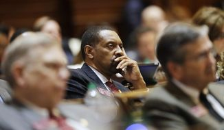 """Rep. Vernon Jones listens as Georgia Gov. Nathan Deal delivers the State of the State address on the House floor in Atlanta, Wednesday, Jan. 11, 2017. Deal is asking Georgia lawmakers to support a new plan for fixing low-performing schools after voters last fall rejected a proposal for state takeovers of schools that consistently struggle. The Republican governor said in his State of the State speech Wednesday that nearly 89,000 students were stuck in failing schools last year and their number """"will grow with each passing school year"""" if nothing is done. (AP Photo/David Goldman)"""