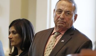 """FILE - In this Monday, Dec. 19, 2016 file photo Maine Republican Gov. Paul LePage, right, and House Speaker Sara Gideon, D-Freeport, attend the Electoral College vote at the State House in Augusta, Maine. LePage says he had weight loss surgery and jokes that now """"there's 50 less pounds of me to hate."""" The Republican revealed the bariatric surgery for the first time Wednesday, Jan. 11. He says he underwent the procedure on Sept. 29 and returned to work a day later. (AP Photo/Robert F. Bukaty)"""
