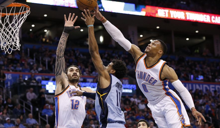 Oklahoma City Thunder guard Russell Westbrook (0) blocks a shot by Memphis Grizzlies guard Mike Conley (11) during the first quarter of an NBA basketball game in Oklahoma City, Wednesday, Jan. 11, 2017. Thunder center Steven Adams is at left. (AP Photo/Sue Ogrocki)