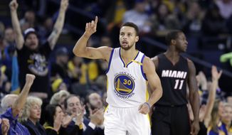 Golden State Warriors' Stephen Curry (30) points after scoring against the Miami Heat during the first half of an NBA basketball game Tuesday, Jan. 10, 2017, in Oakland, Calif. (AP Photo/Marcio Jose Sanchez)