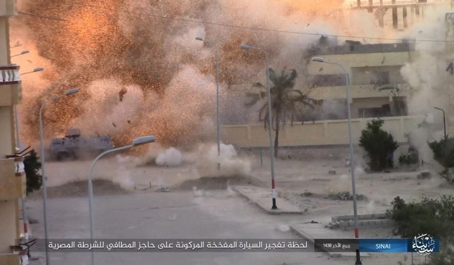"This photo posted on a file sharing website Wednesday, Jan. 11, 2017, by the Islamic State Group in Sinai, a militant organization, shows an explosion as militants attack an Egyptian police checkpoint on Monday, Jan. 9, 2017, in el-Arish, north Sinai, Egypt. An Israeli defense official said Wednesday  that the country has developed a new policy in recent years to allow Egypt to quickly beef up its forces in the volatile Sinai peninsula as part of a shared struggle against Islamic militants. The comments came days after Egyptian President Abdel-Fatteh el-Sissi said there are about 25,000 Egyptian troops operating in Sinai. Arabic reads, ""The moment a car bomb explodes next to an Egyptian Police fire station checkpoint."" (Islamic State Group in Sinai, via AP)"