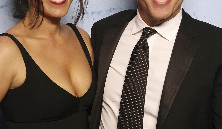 FILE - In this Sept. 16, 2007 file photo, Jon Stewart and his wife Tracey pose for photographers at the Comedy Central party in Los Angeles.   Stewart and his wife have received a key approval to open an animal sanctuary in New Jersey. The Colts Neck planning board approved preliminary plans for the 45-acre farm that will be the home of animals saved from slaughterhouses, roadsides and live markets. Tracey Stewart says Tuesday, Jan 10, 2017 approval means the farm should open by 2018. (AP Photo/Rene Macura)