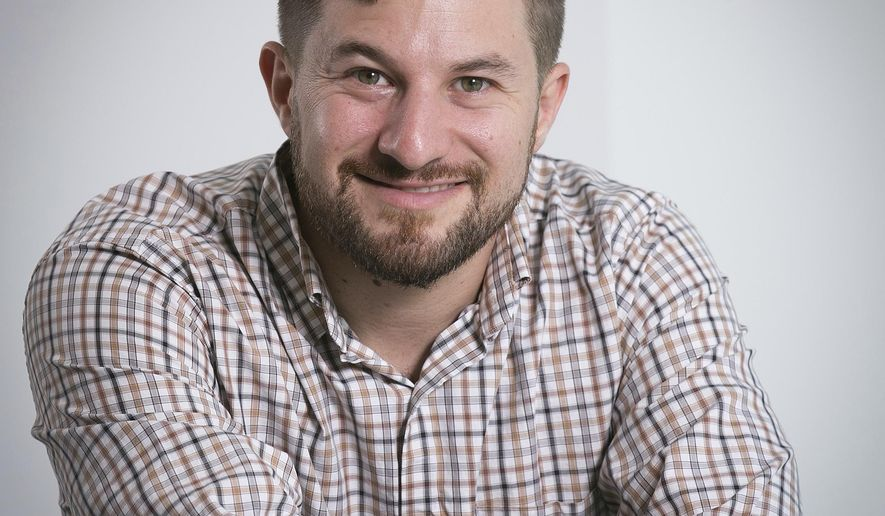 In this Tuesday, Aug. 9, 2016 photo, Ezra Kaplan poses for a photo, in New York. Kaplan, a multi-media journalist with experience covering breaking news and overseas assignments, has been hired by The Associated Press to help cover the 2017 legislative session in Georgia. The 28-year-old most recently freelanced for the AP in New York where he also participated in the company's internship program. (AP Photo/Richard Drew)