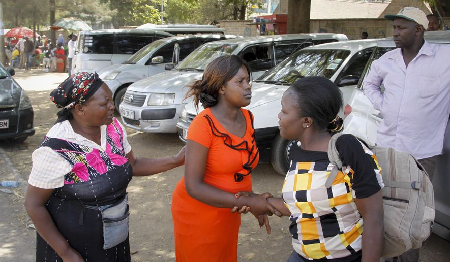 In this photo taken Monday, Jan. 9, 2017, pregnant Sharon Andisi, 23, arrives outside the Pumwani Maternity Hospital, only to be turned away because of a month-long strike by state doctors, in Nairobi, Kenya. Such scenes have become frequent across Kenya as the doctors' strike stretches into a second month, with doctors adamant that President Uhuru Kenyatta's government must honor a collective bargaining agreement it signed in 2013 to increase their salaries by 180 percent. (AP Photo/Khalil Senosi)