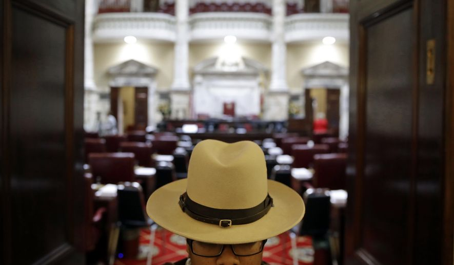 In this file photo, a Maryland State Trooper stands guard at the doors to the Maryland State Senate chamber in Annapolis, Md., Wednesday, Jan. 11, 2017, the first day of the 2017 legislative session. (AP Photo/Patrick Semansky) **FILE**