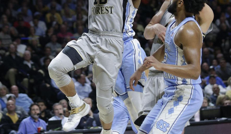 Wake Forest's Mitchell Wilbekin (10) drives to the basket past North Carolina's Joel Berry II (2) during the first half of an NCAA college basketball game in Winston-Salem, N.C., Wednesday, Jan. 11, 2017. (AP Photo/Chuck Burton)