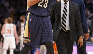 New Orleans Pelicans forward Anthony Davis leaves the court after he was injured in a collision with New York Knicks' Kyle O'Quinn during the second half of an NBA basketball game at Madison Square Garden in New York, Monday, Jan. 9, 2017. Davis had 40 points and 18 rebounds before leaving with a left hip injury after a hard foul in the Pelicans' 110-96 victory. (AP Photo/Kathy Willens)