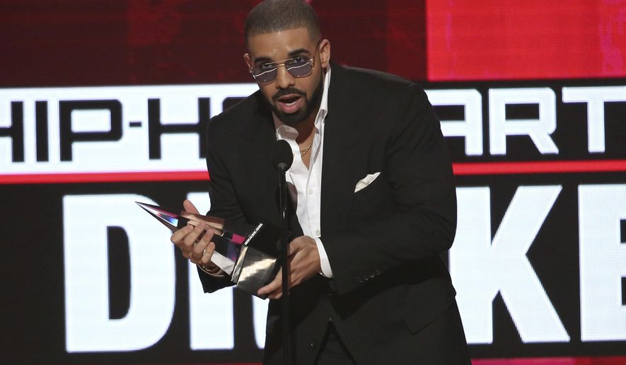 FILE - In this Nov. 20, 2016, file photo, Drake accepts the award for favorite artist - rap/hip-hop at the American Music Awards at the Microsoft Theater in Los Angeles. Drake is saluting President Barack Obama with a bizarre image of the Canadian rapper's face mixed with the president's. He shared the picture on Instagram Jan. 10, 2017, following Obama's farewell speech.(Photo by Matt Sayles/Invision/AP, File)
