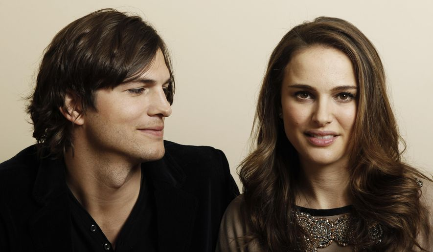 "In this Jan. 7, 2011, file photo, actor Ashton Kutcher, left, and actress Natalie Portman, from the film ""No Strings Attached"" pose for a portrait in Beverly Hills, Calif. Portman tells Marie Claire magazine in an interview published Jan. 11, 2017, that Kutcher was paid three times as much as her for co-starring in the 2011 film. (AP Photo/Matt Sayles, File)"