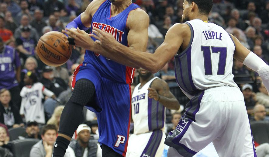 Detroit Pistons forward Tobias Harris (34) is fouled while driving to the basket by Sacramento Kings defender Garrett Temple (17) during the first half of an NBA basketball game in Sacramento, Calif., Tuesday, Jan. 10, 2017. (AP Photo/Steve Yeater)
