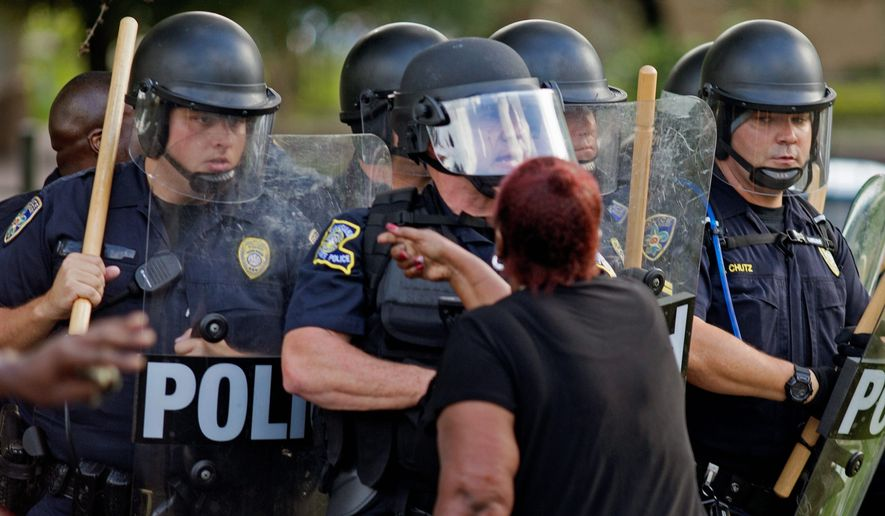 Two-thirds of officers say protesters who fill American streets in the wake of police shootings are motivated by anti-police bias rather than a desire to hold officers accountable for their actions. (Associated Press)