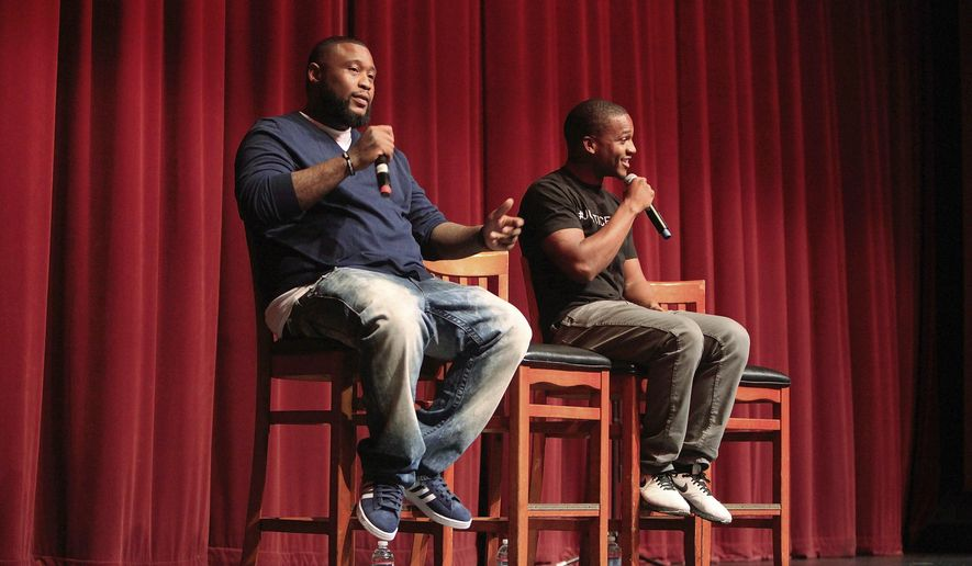 "In this Dec. 4, 2015, photo, Brandon ""Tiny Doo"" Duncan, left, and Aaron Harvey talk about their experience with Penal Code 182.5 during a community forum at Lincoln High School in San Diego, Calif. Duncan and Harvey, a community organizer, sued the city of San Diego on Tuesday, Jan. 10, 2017, for federal civil rights violations over being jailed on gang-related charges that were based on their rap lyrics and social media postings. (Misael Virgen/The San Diego Union-Tribune via AP)"