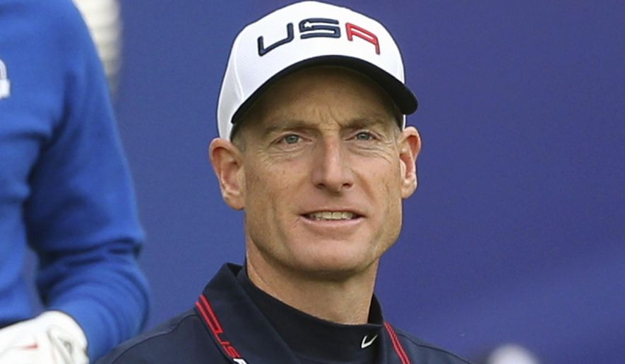 FILE - In this Sept. 28, 2014, file photo, Jim Furyk, of the United States, walks off the tee box after playing the first hole during a singles match on the final day of the Ryder Cup golf tournament, at Gleneagles, Scotland. Furyk has been appointed U.S. captain for the 2018 Ryder Cup in France. Furyk will be in charge of a team that will try to win on European soil for the first time since 1993 at The Belfry. (AP Photo/Scott Heppell, File)