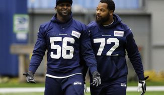 Seattle Seahawks defensive ends Cliff Avril (56) and Michael Bennett (72) walk at the start of practice, Tuesday, Jan. 10, 2017, in Renton, Wash. The Seahawks are scheduled to play the Atlanta Falcons in an NFL football NFC playoff game Saturday in Atlanta. (AP Photo/Ted S. Warren)